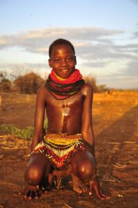 Nyangatom Girl with traditional beading skirt
