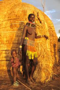 Nyangatom mother and child in front of their hut